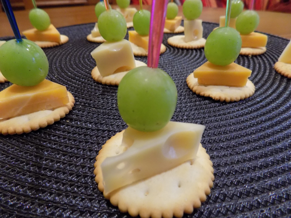 canapes of cheese and grapes